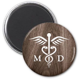 MD medical doctor with caduceus on wood background 2 Inch Round Magnet