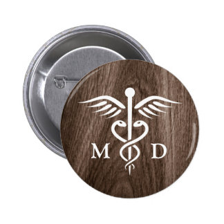 MD medical doctor with caduceus on wood background Pinback Button