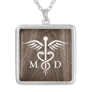 MD medical doctor with caduceus on wood background Silver Plated Necklace
