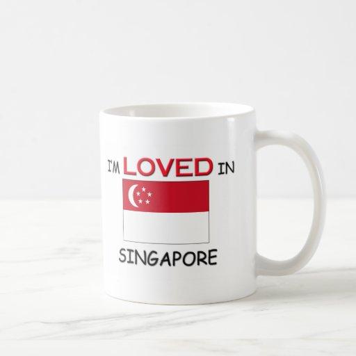 Me aman en SINGAPUR Tazas