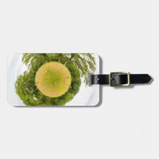 Meadow with trees like little planet bag tag