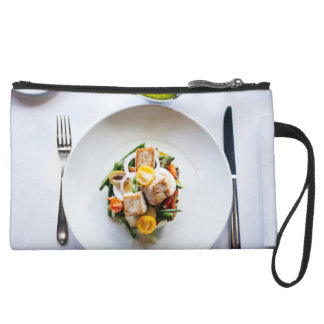 meal suede wristlet
