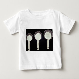 Measuring cups in different size t shirts
