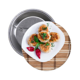 Meatballs of minced chicken with red pepper button