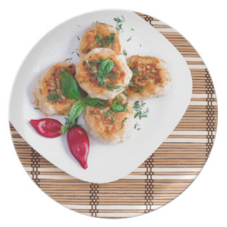 Meatballs of minced chicken with red pepper dinner plate