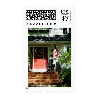 Mecedoras por las puertas rojas timbre postal