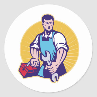 Mechanic tradesman worker holding spanner toolbox classic round sticker