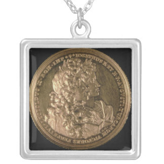 Medallion bearing portraits silver plated necklace