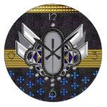 medallón con alas deco del monograma relojes