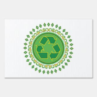 Medallón verde que recicla la muestra señales