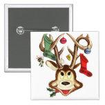 Medias del navidad y astas de los ciervos pins