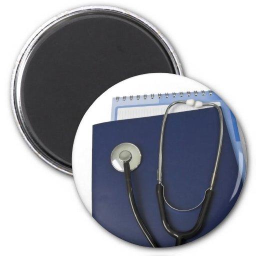 medical stethoscope on blue folder refrigerator magnets