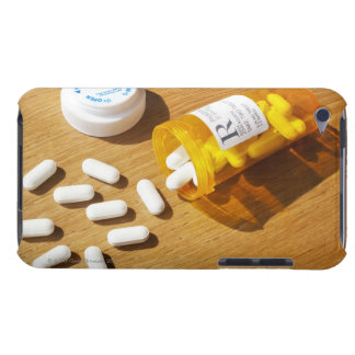 Medication spilled on table iPod touch case