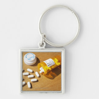 Medication spilled on table keychains
