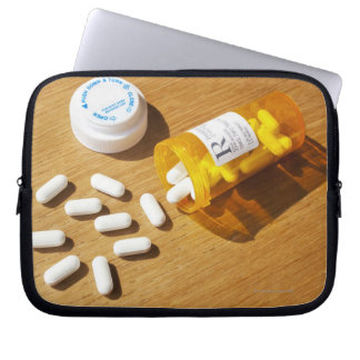 Medication spilled on table computer sleeves
