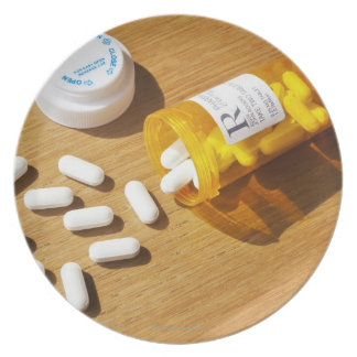 Medication spilled on table melamine plate