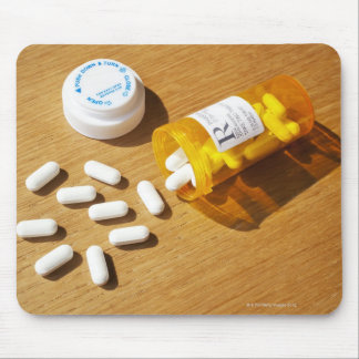 Medication spilled on table mouse pad