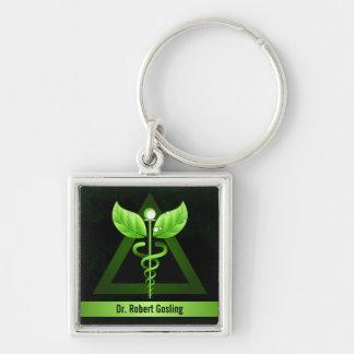 Medicina alternativa del caduceo verde oscuro de llavero cuadrado plateado