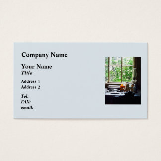Medicine and Hurricane Lamp on Desk Business Card