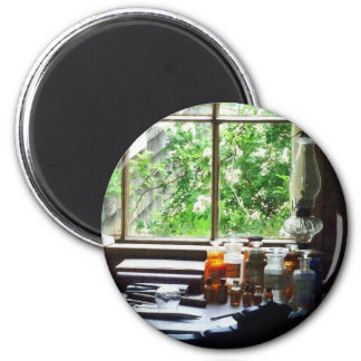 Medicine and Hurricane Lamp on Desk 2 Inch Round Magnet