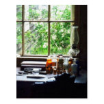 Medicine and Hurricane Lamp on Desk Post Cards