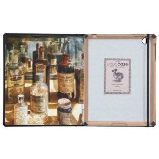 Medicine Bottles in Glass Case iPad Case