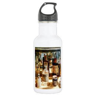 Medicine Bottles in Glass Case