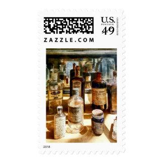 Medicine Bottles in Glass Case Postage