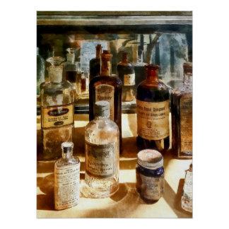 Medicine Bottles in Glass Case Poster