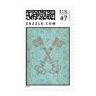 Medieval 21st keys against vintage blue pattern postage
