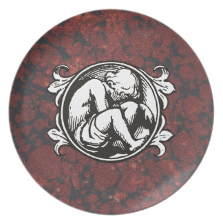Medieval child (boy) against vintage marble melamine plate