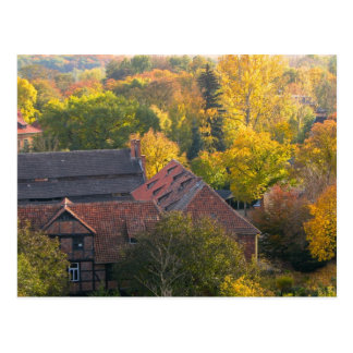 Medieval town in fall postcard