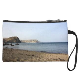 Mediterranean Sea and beach the Blacks, photograph Suede Wristlet Wallet