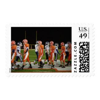 Meeting of teams of American football in field, Postage