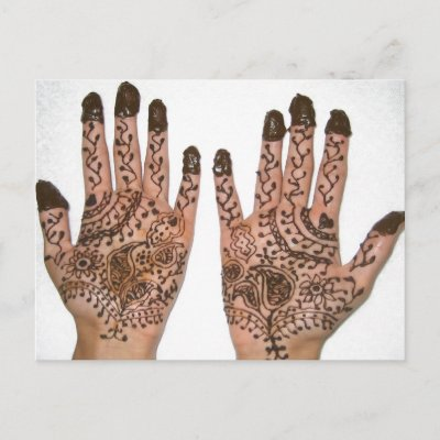 Hands covered with Henna, a temporary Tattoo. Hands are decorated for a