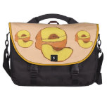 Melocotones - en un fondo del melocotón bolsas para portátil
