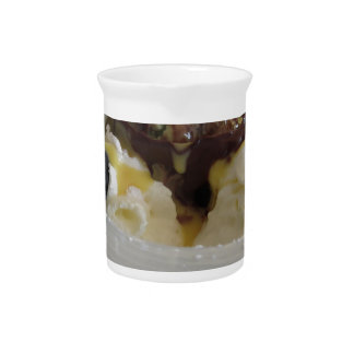 Melted chocolate ball with zabaglione cream drink pitcher