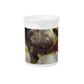 Melted chocolate ball with zabaglione cream pitcher
