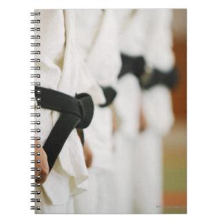 Members of a Judo Dojo Lined Up Notebook