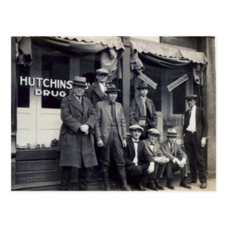 Men In Front of  Hutchings-Davis Drug Store Postcard