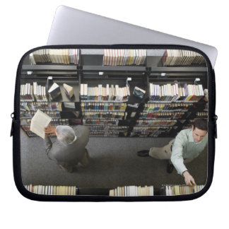 Men in library looking for books laptop computer sleeves