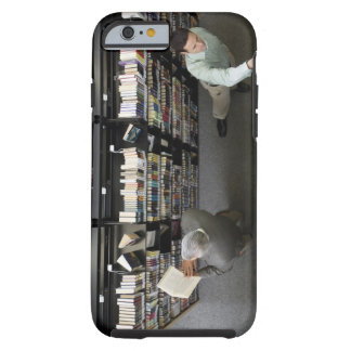 Men in library looking for books tough iPhone 6 case