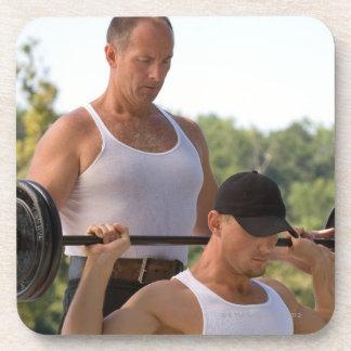 Men lifting barbell drink coaster