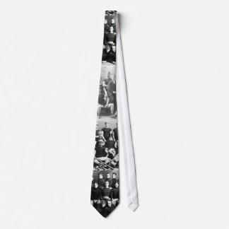 Men, mostly, in black. neck tie