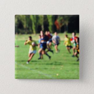 Men playing in park, defocused pinback button