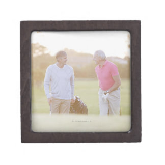 Men pulling golf carts gift box