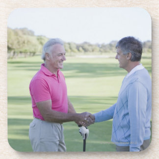 Men shaking hands on golf course coaster