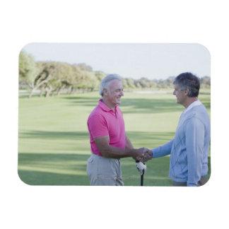 Men shaking hands on golf course magnet