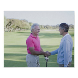 Men shaking hands on golf course poster