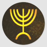 "Menorah Flame Classic Round Sticker<br><div class=""desc"">A digital rendering of the Jewish seven-branched menorah (Hebrew: מְנוֹרָה‎). The seven-branched menorah, used in the portable sanctuary set up by Moses in the wilderness and later in the Temple in Jerusalem, has been a symbol of Judaism since ancient times and is the emblem on the coat of arms of...</div>"